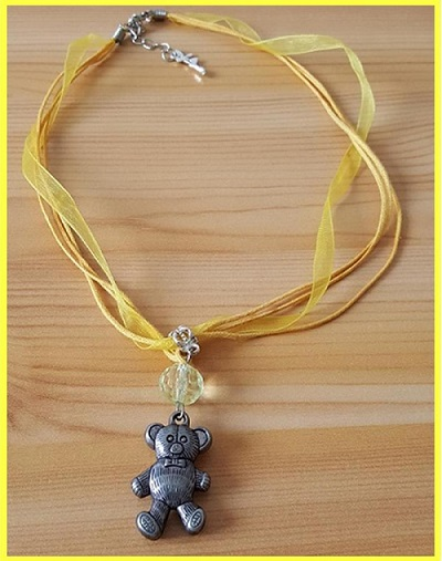 Collier jaune ours